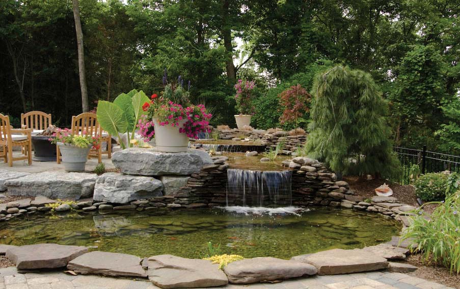 waterfall koi pond next to patio